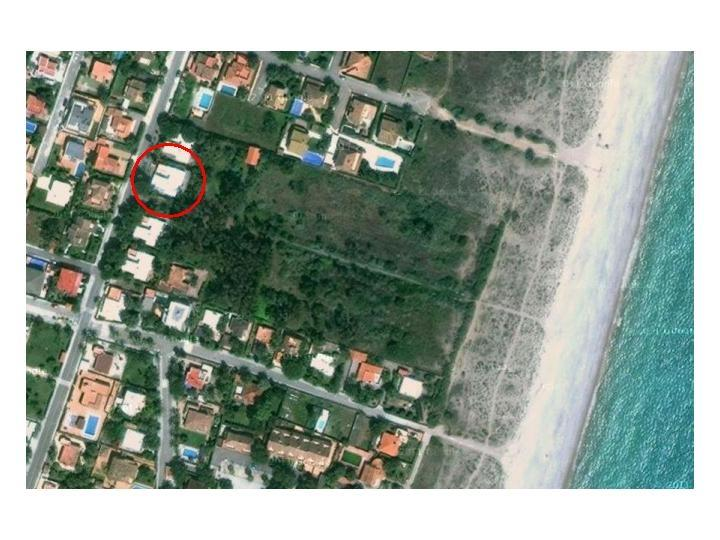 Aerial view of house and parc and private path to the beach