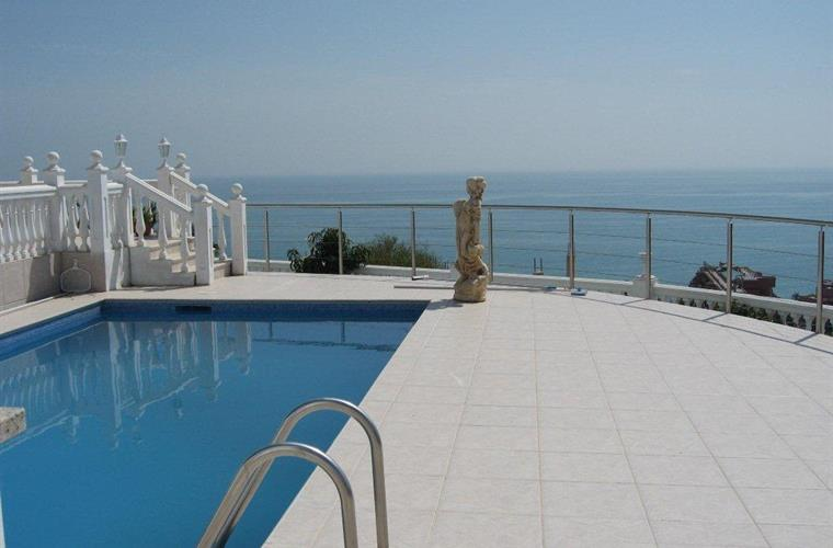 Panoramic view from terrace and pool over the Mediterranean Sea.