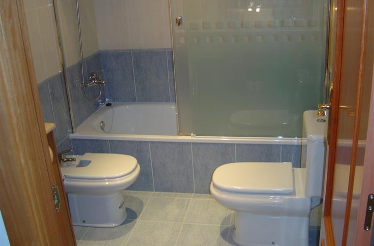 Bathroom with bath/shower, bidet and second toilet