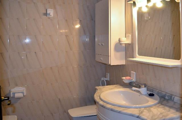 Bathroom with bath, toilet, bidet and shower