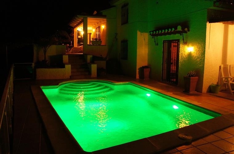 Watch the pool lights change colour by night,, amazing