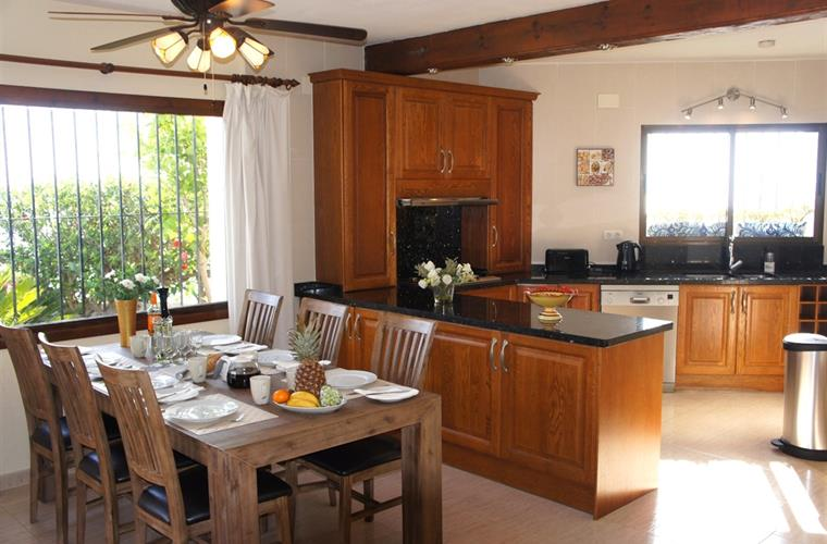 Open plan dinning and kitchen fully equipped and ready for you.