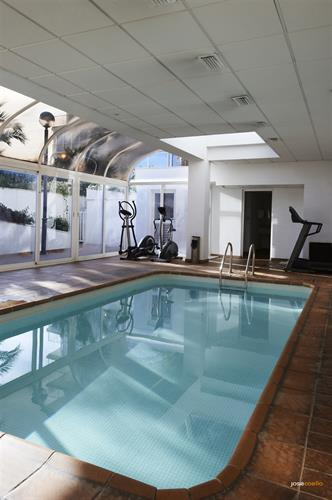 indoor pool with jets pressure, fitness center and sauna
