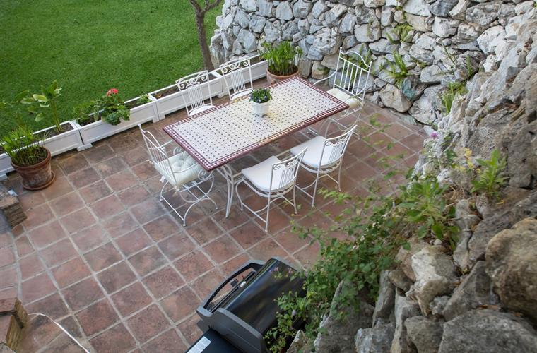 Dining outdoor terrace with dinning table and BBQ grill