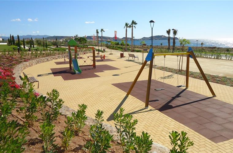 Oceanfront children s playground directly in front of the complex