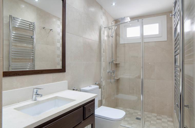 En suite bathroom of Bedroom 1. Walk in shower. Heated towel rail.