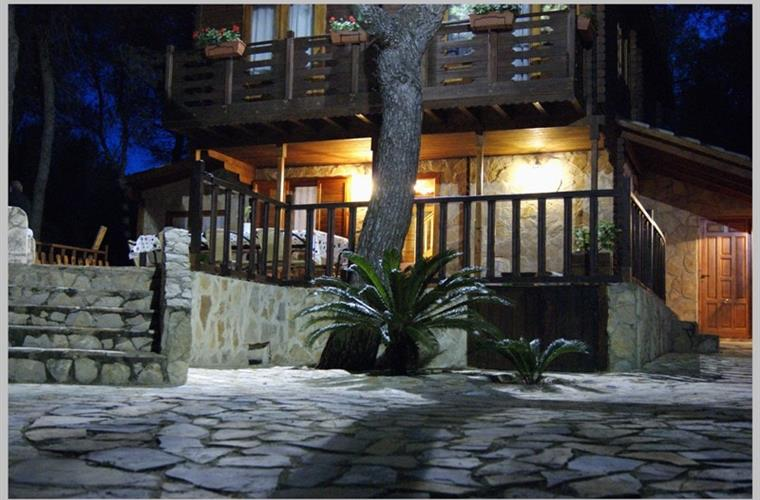"""Manzana"" home at night"