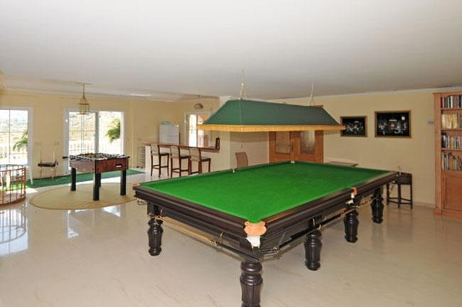 Games room in the basement with bar area
