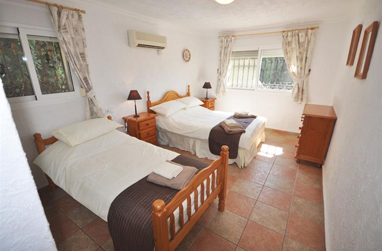 Lodge bedroom with single and double beds
