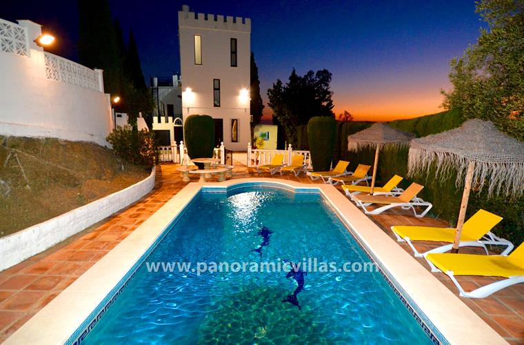 View across the private heated pool and terrace at night