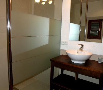 bathroom to one of the bedrooms, entrance level