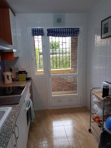 Kitchen with door leading to Utility room...