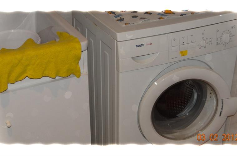 Washing machine in separate laundry room