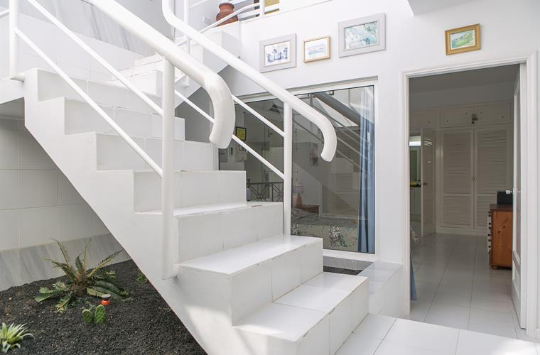stairs to bedroom and garden