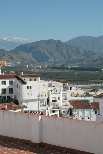 A view of the village and Sierra Nevada from the terrace.