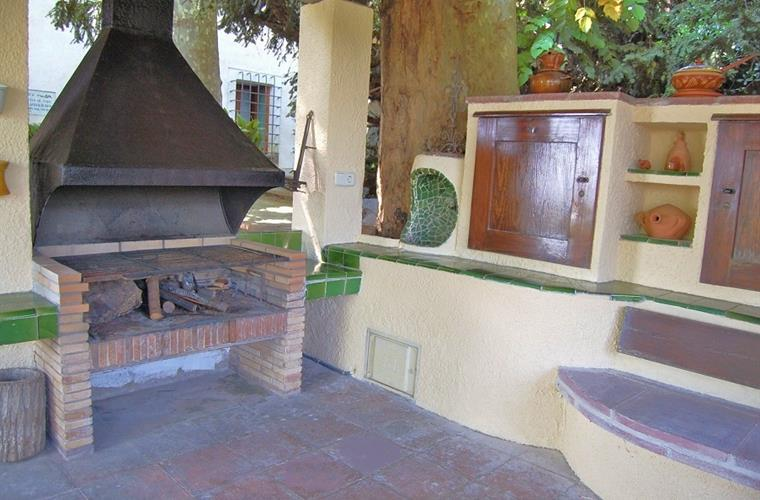 You have your very own BBQ and outdoor kitchen