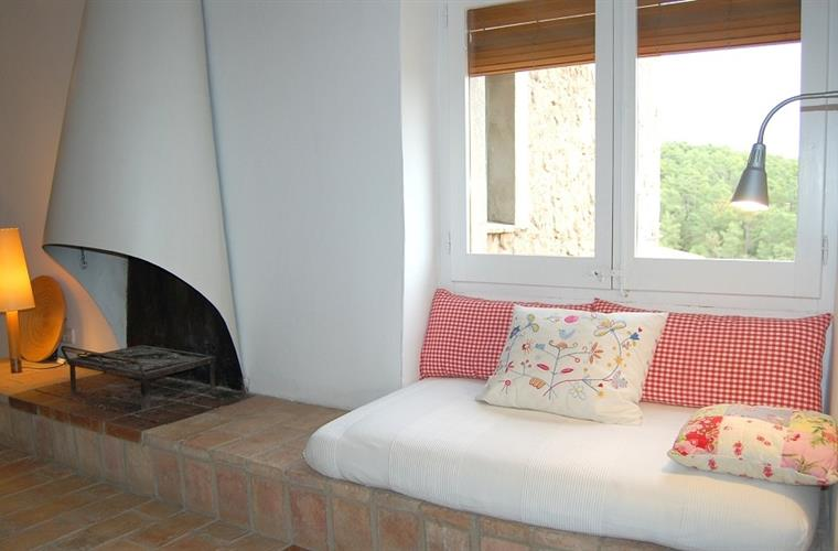 Relax in the sofas by the fireplace