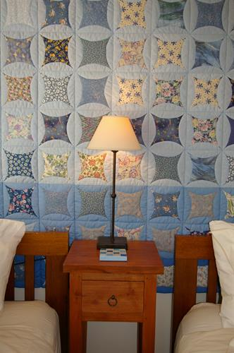 Beautiful hand-crafted quilt in Bed 2