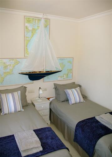 Bed 3 - the maritime Endeavour room with views across pool