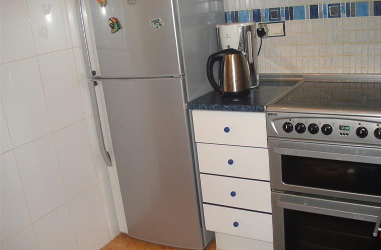 Full working kitchen , with double fan assisted oven .