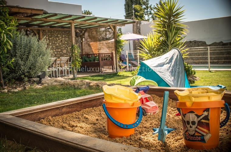 Kids play, sandpit and toys