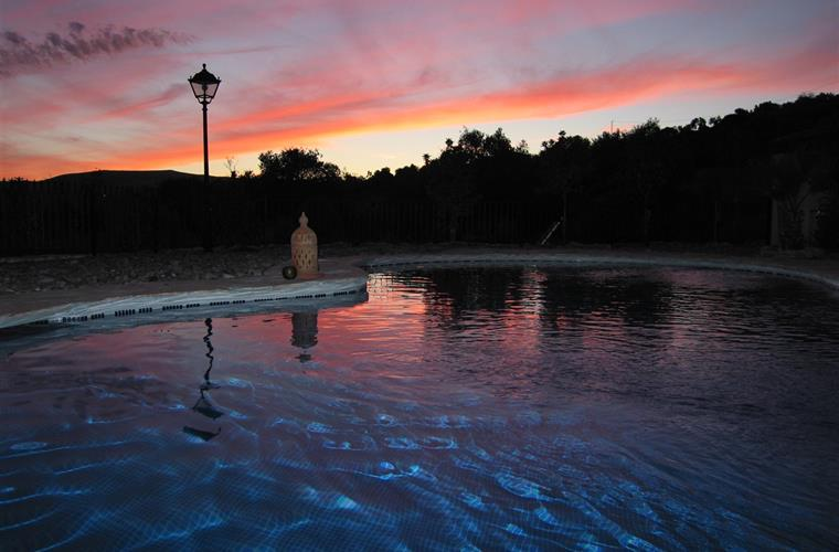Sunset over pool and terrace