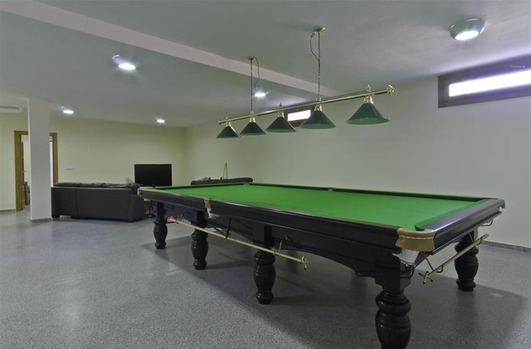 Games room in basement. Full size Snooker table.