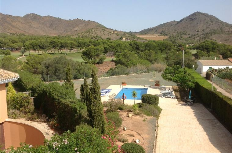 View from rear bedroom terrace, pool & golf fairway.