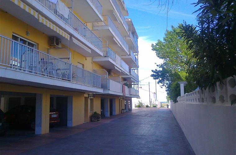Enclosed private parking downstairs. Direct access to beach at end