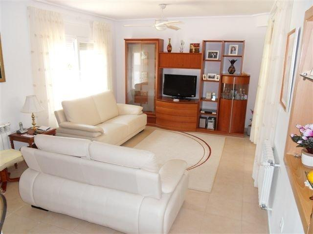 The living room with leather sofas, LCD TV and air conditioning