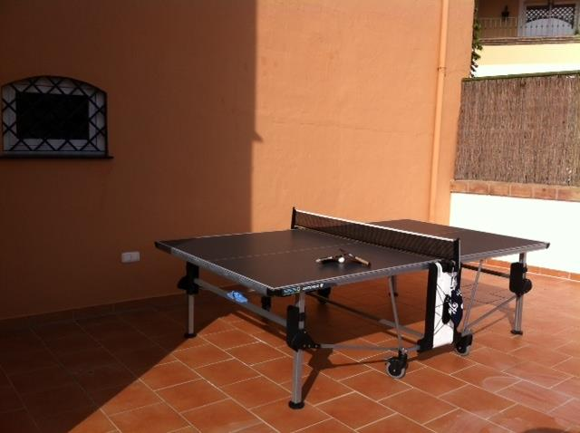 Table tennis on terrace & pool floor.
