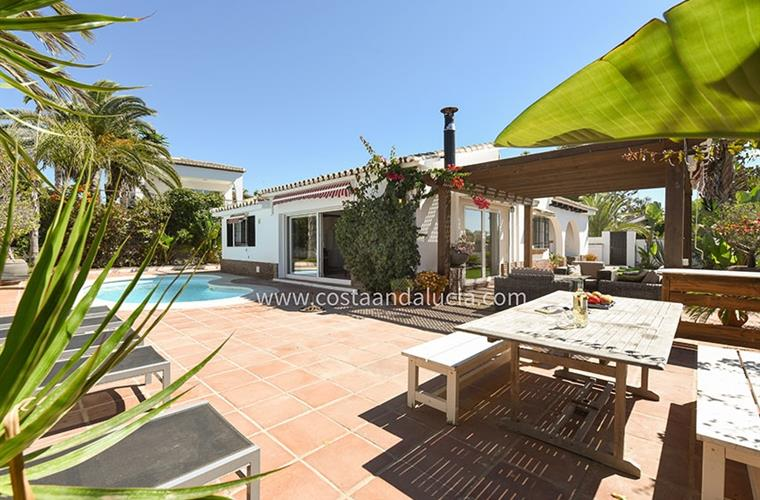 Terrace with pool and garden around the villa in Marbesa  Marbella