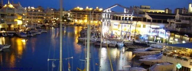 """Puerto Marina"" at night"