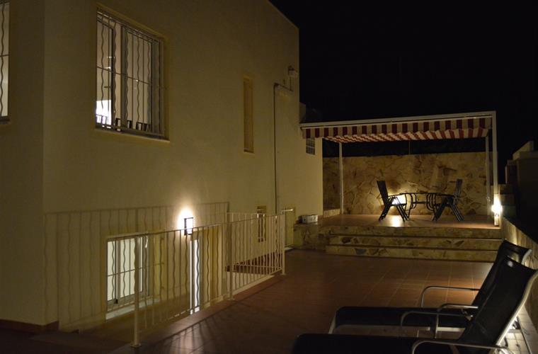 garden with wall lights by night