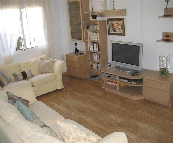 Light and comfortable living room with TV and DVD player.