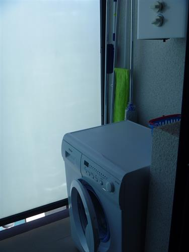 Extra small terace attached to kitchen with washing machine