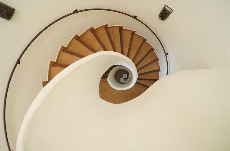 The spiral staircase at the core of the villa