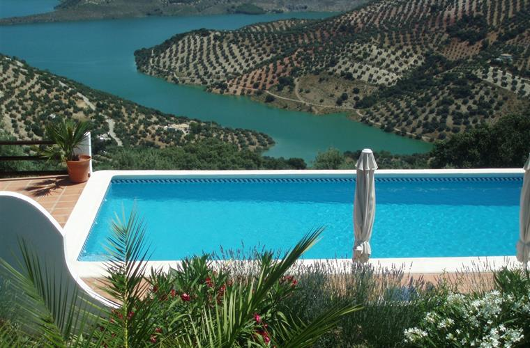 View over the pool down to Lake Iznajar