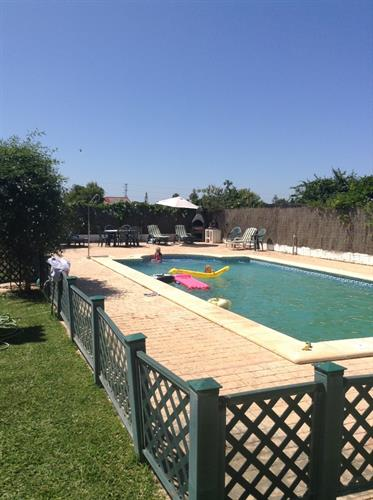 Swimming pool showing low fence round the pool