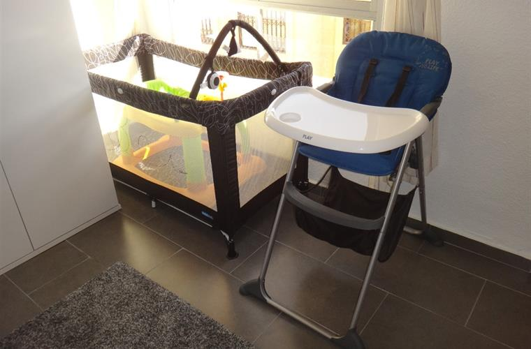 Portable cot, baby walker & high chair - in  main bedroom