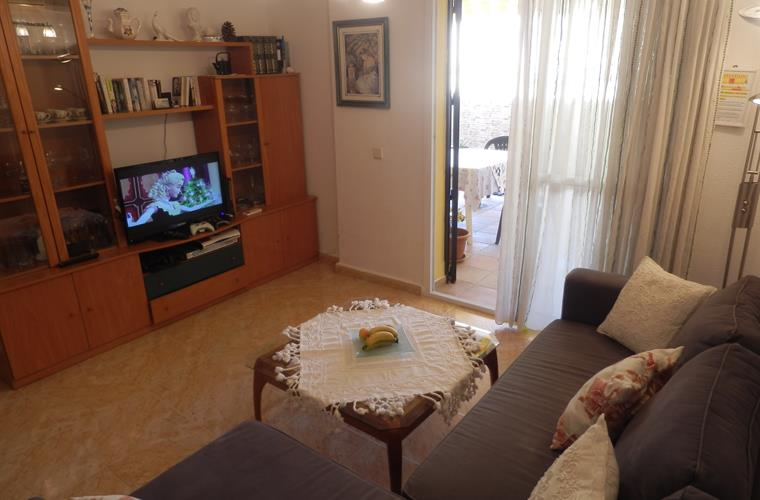 Living room with dining table, TV and sofabed
