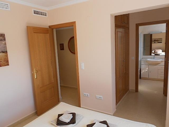 En suite bathroom and walk past wardrobes as seen from main bed