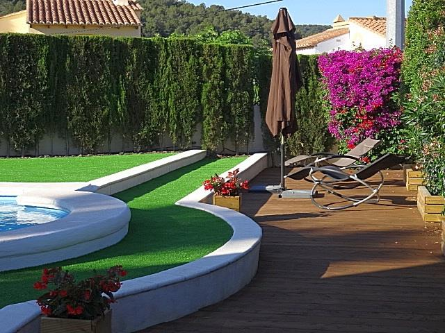 Wooden decking by the pool