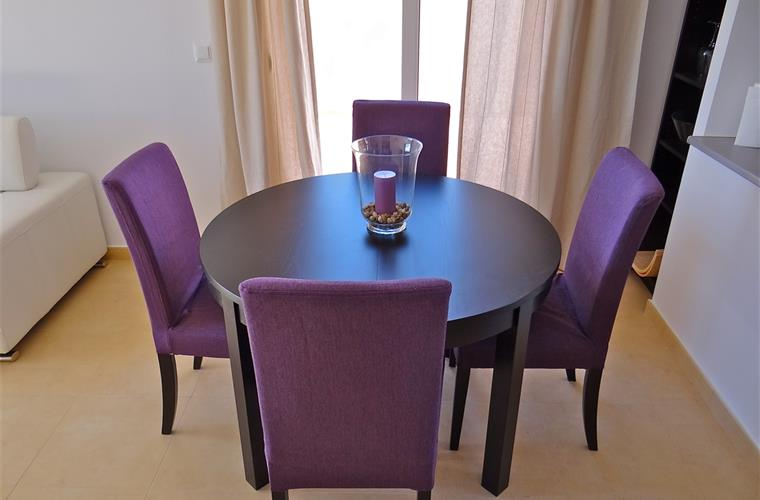 Dining area with an extendable table