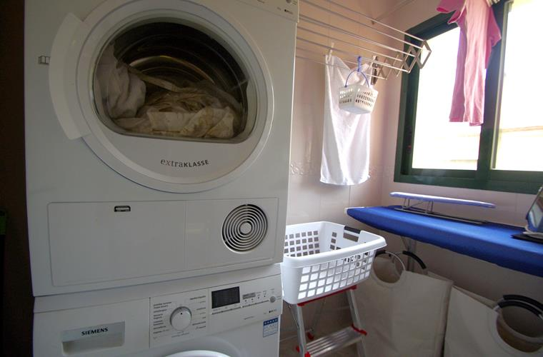 utility room with washing machine and dryer, iron etc.