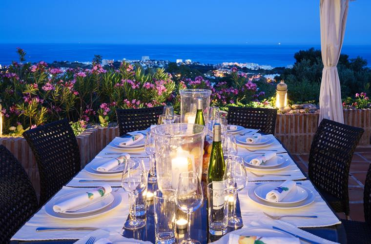 candlelight dinner on seaside terrace