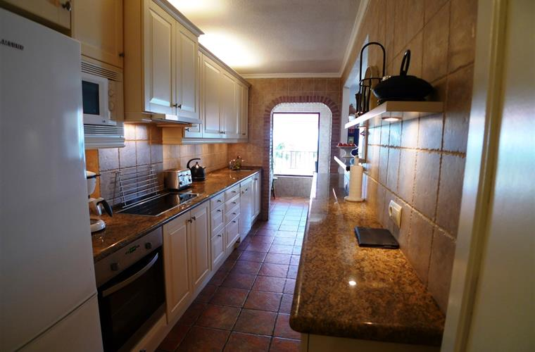 Fully equipped kitchen with fridge, oven, microwave and dishwasher