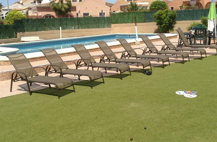 8 sun beds with lots of space on the AstroTurf for playing games