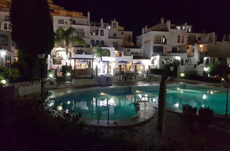Night time view of pool and Clubhouse