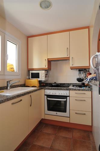 1st floor kitchen with oven, microwave, dishwasher and fridge